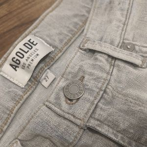 Distressed light gray skinny jeans